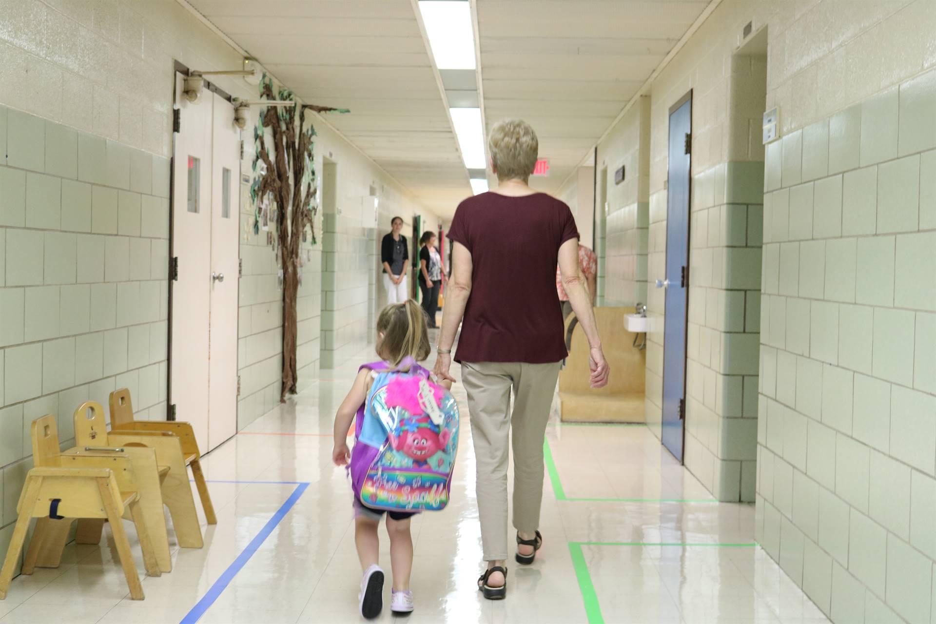 teacher walking student in hall