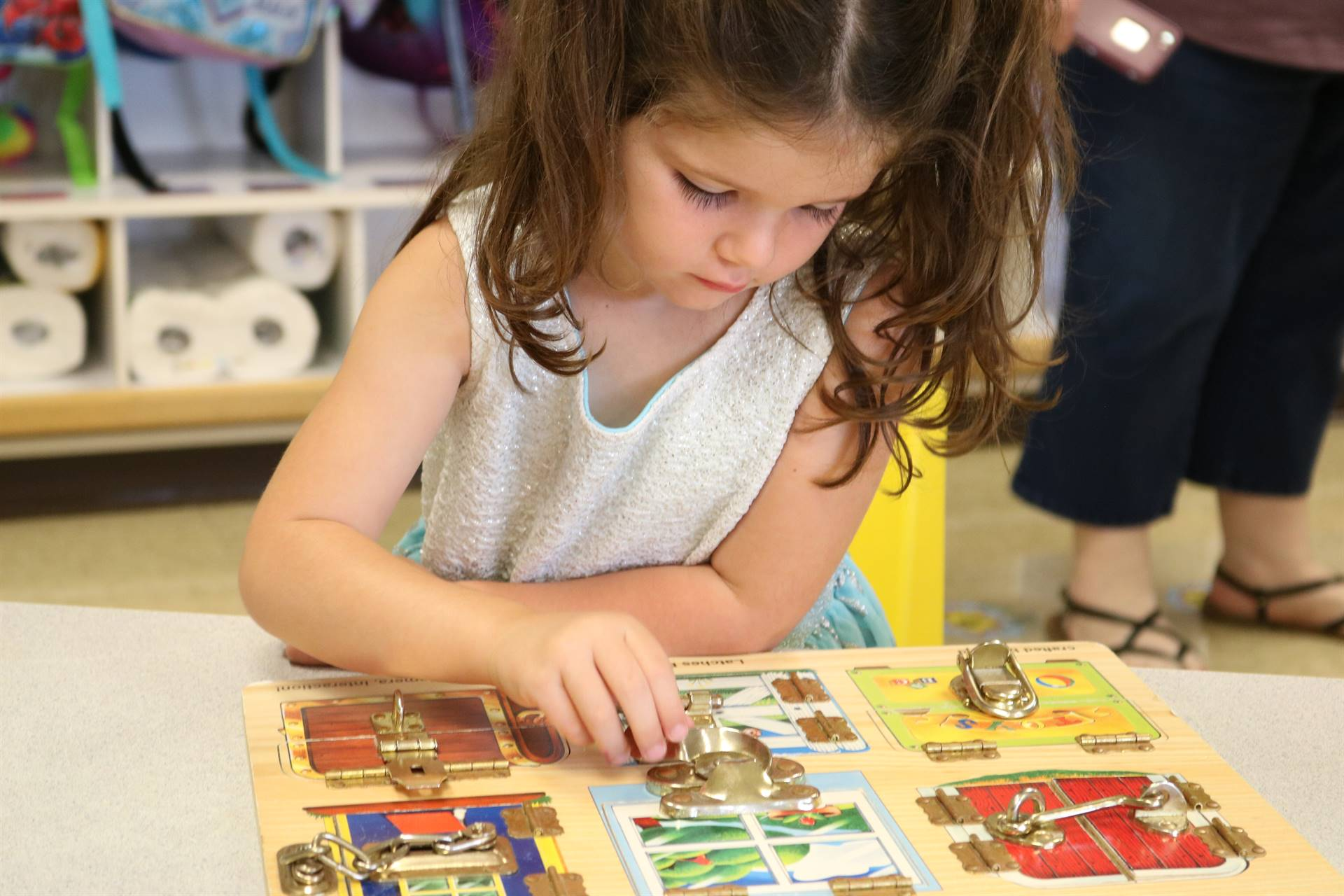 girl playing with locks in  a book
