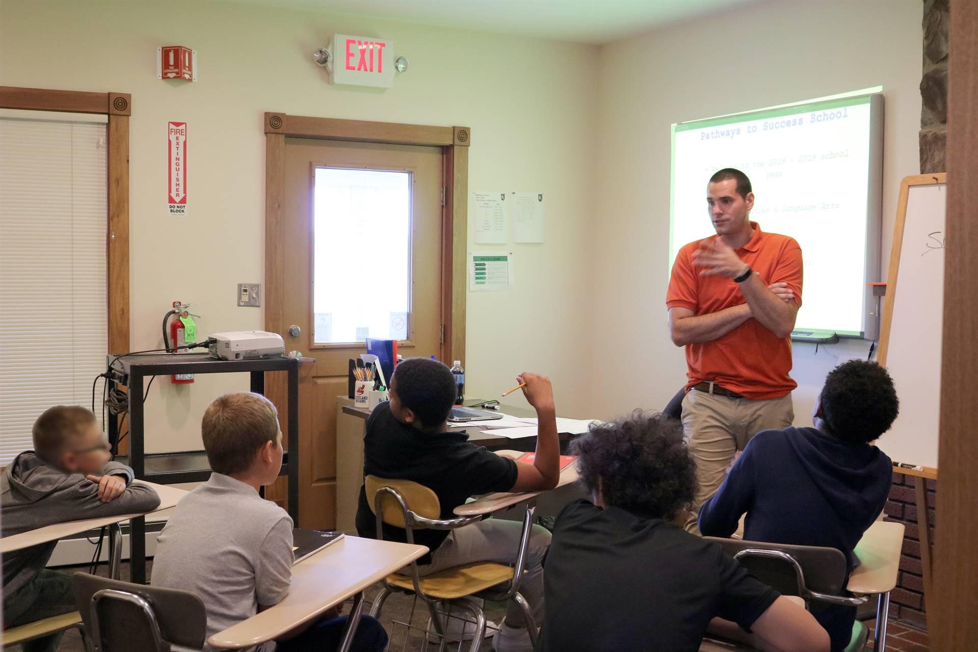 male teacher teaching 5 males