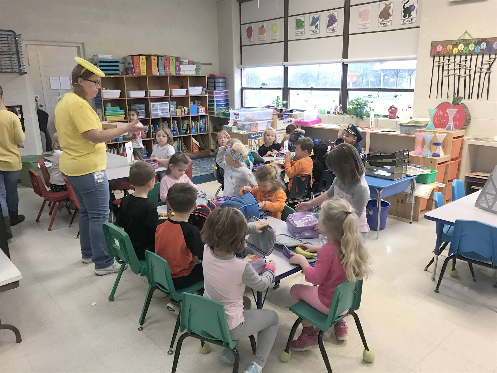 pre k class with costumes at tables
