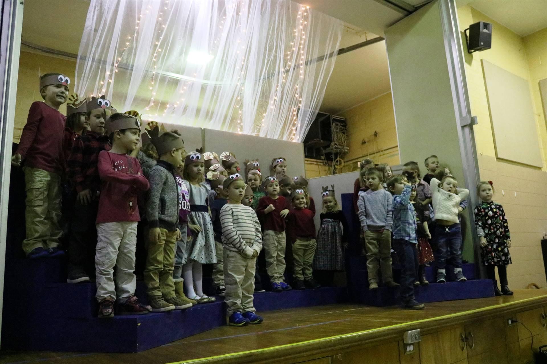 group of preschoolers singing on stage