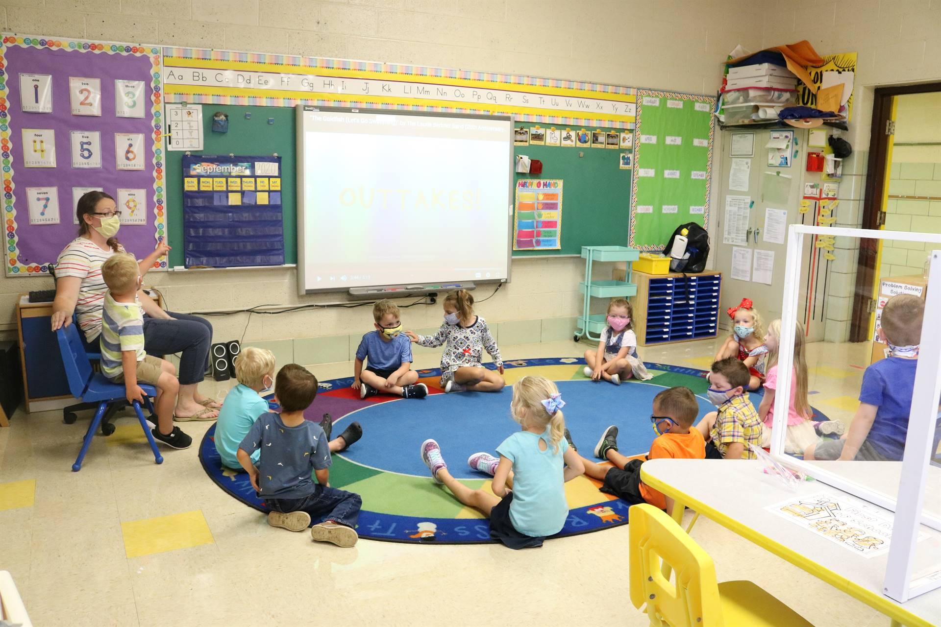 kids sitting in circle on floor