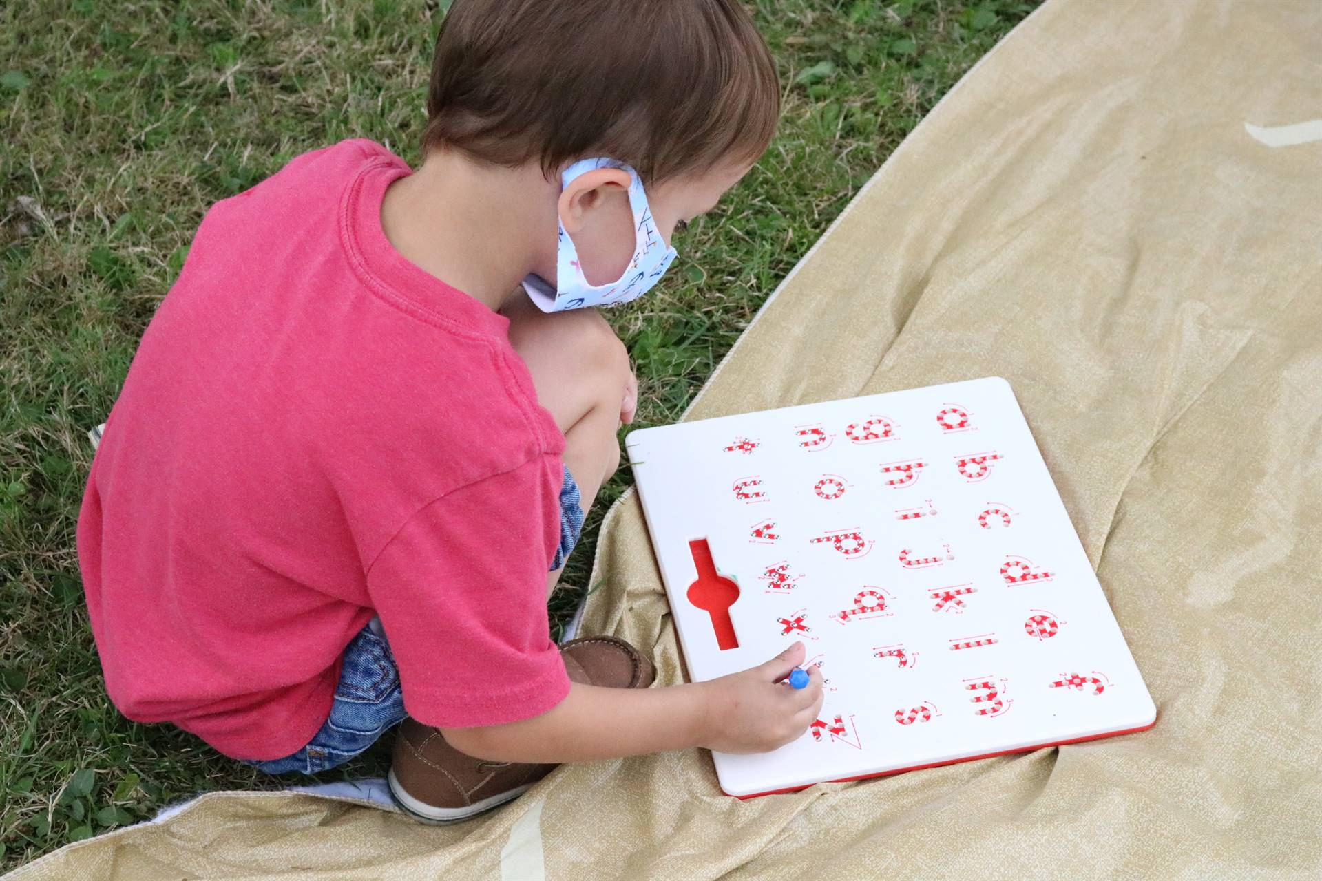 boy with board of alphabet letters