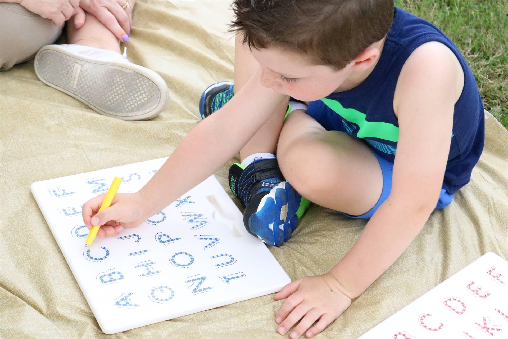 boy with alphabet board