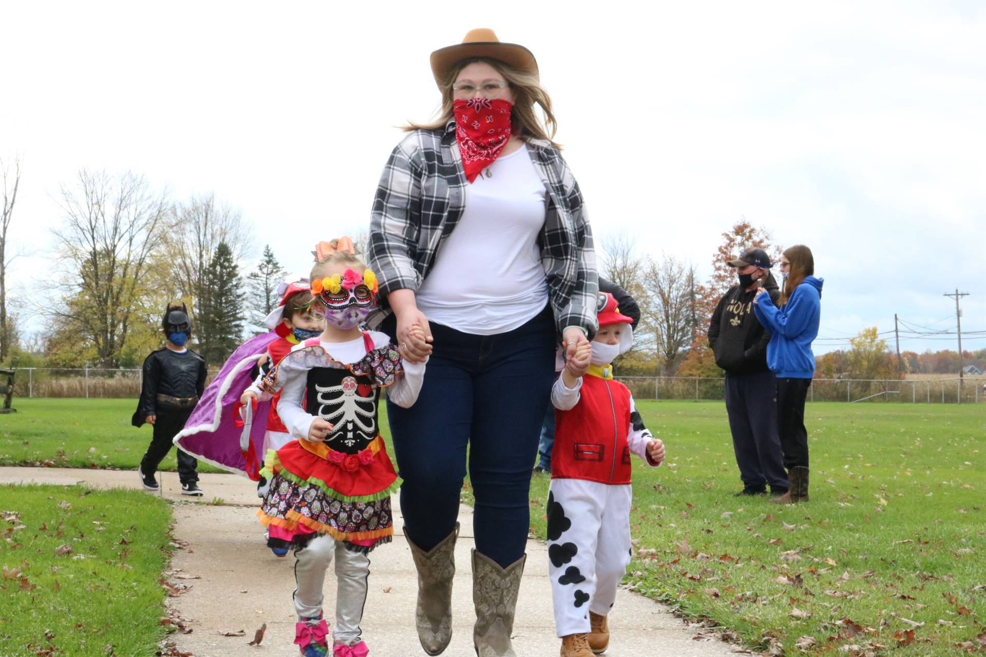 lady dressed as cowgirl with 2 kids