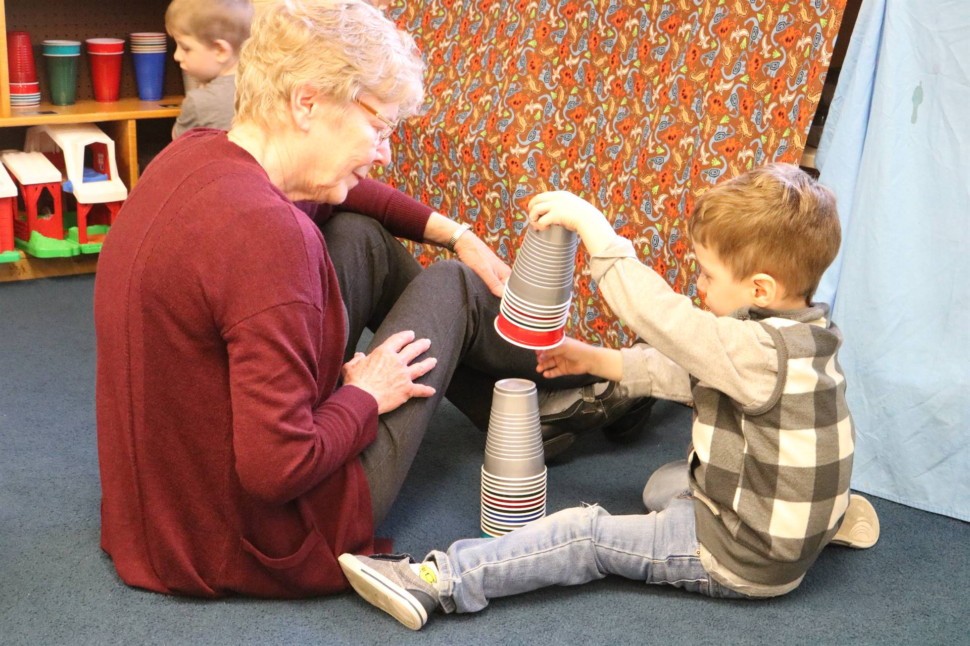 boy stacking cups