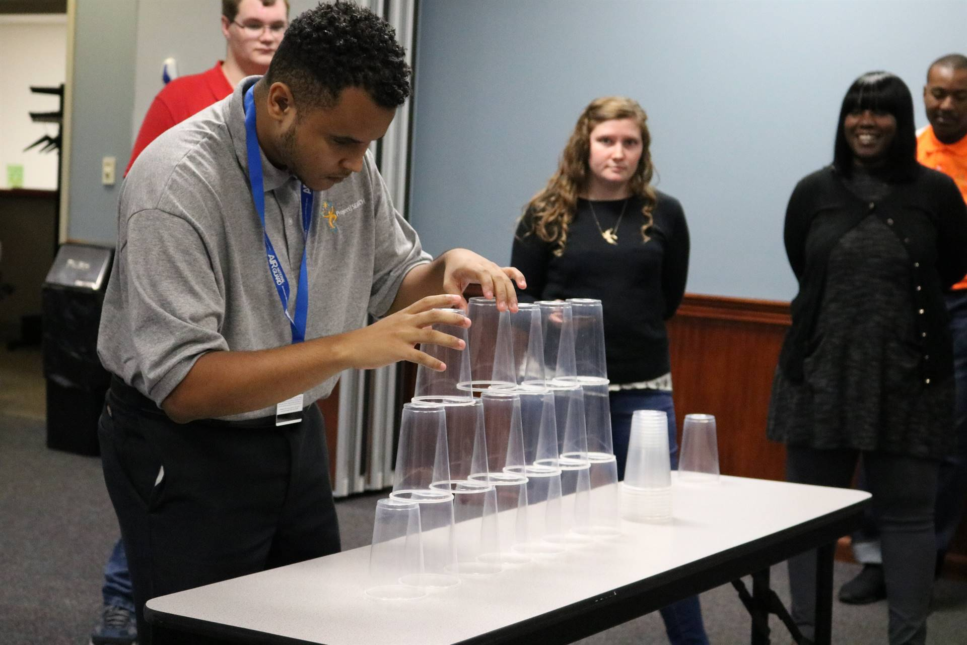 colored boy stacking cups