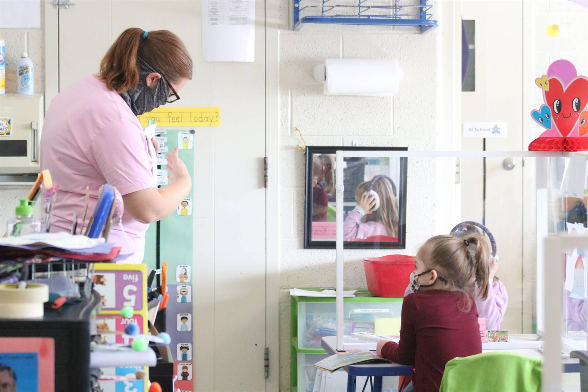 teacher talking to 2 girls