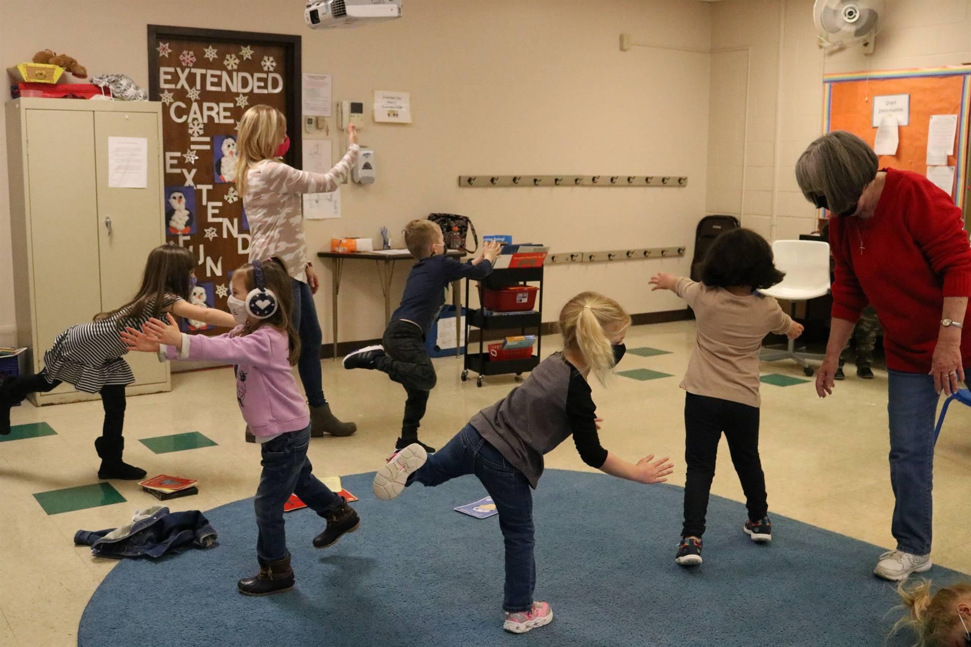 classroom little kids doing yoga