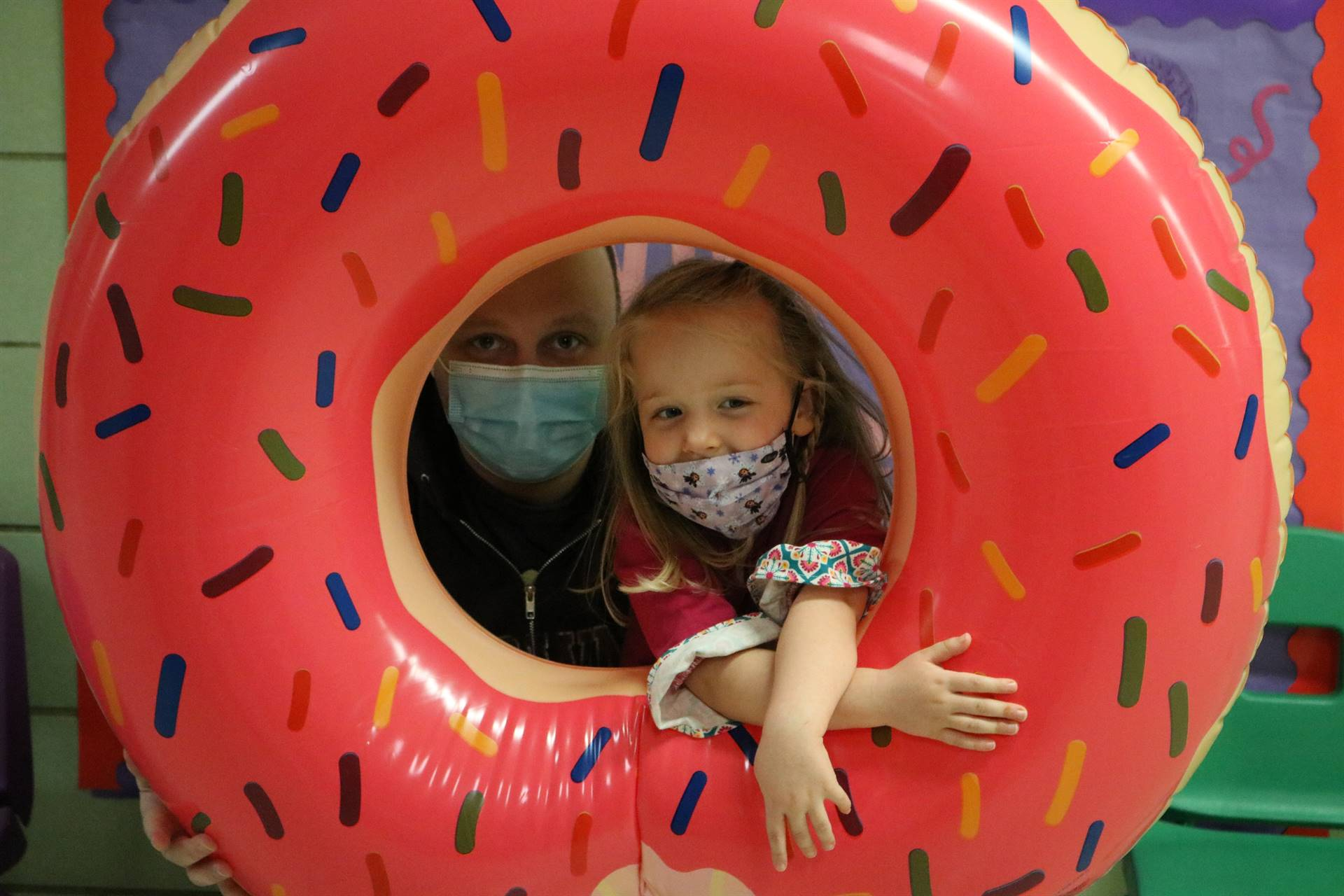 dad and girl in donut inflatable