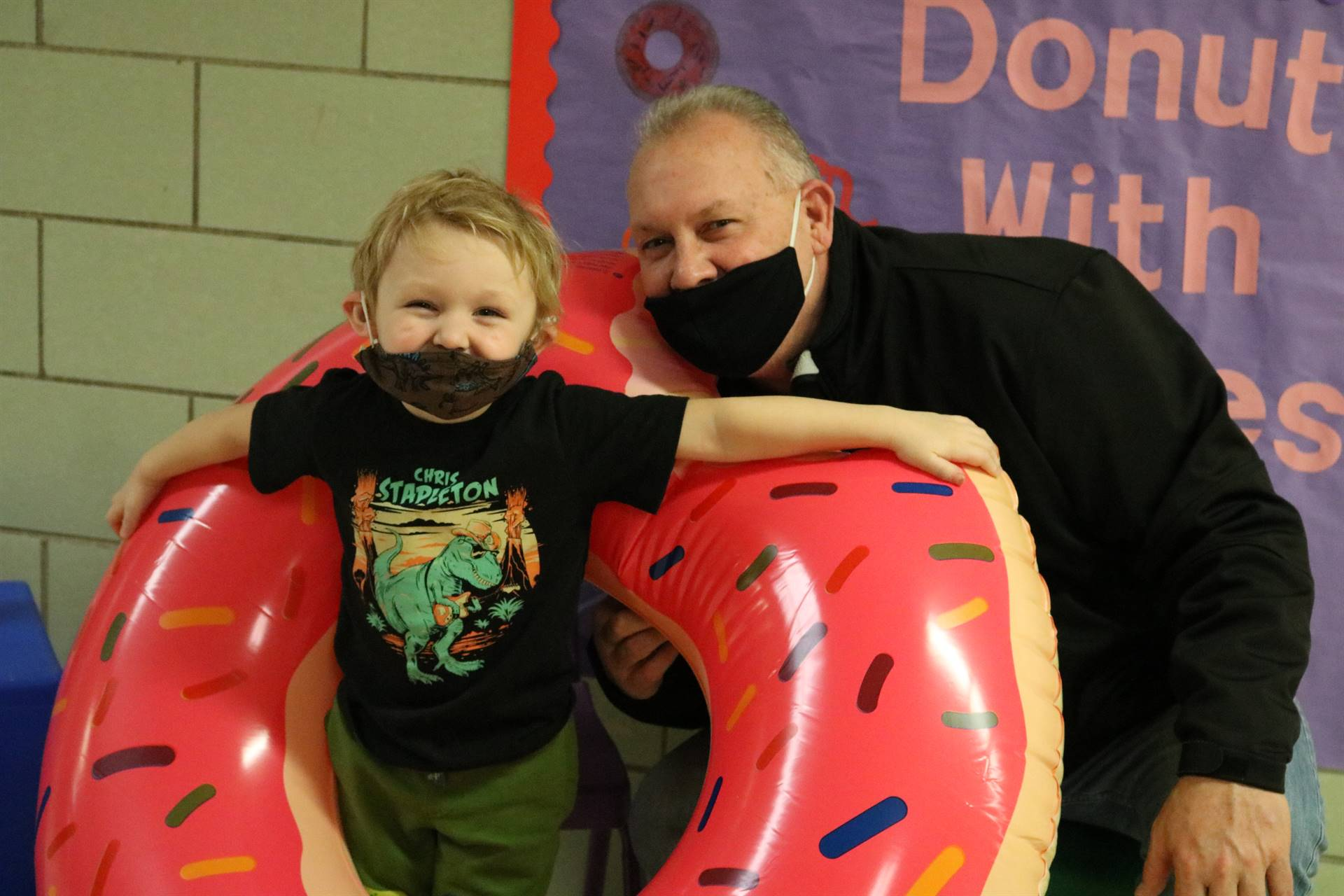 dad and boy in donut inflatable