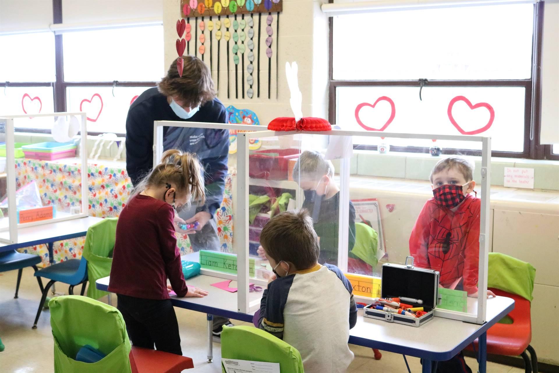 kids standing by desks