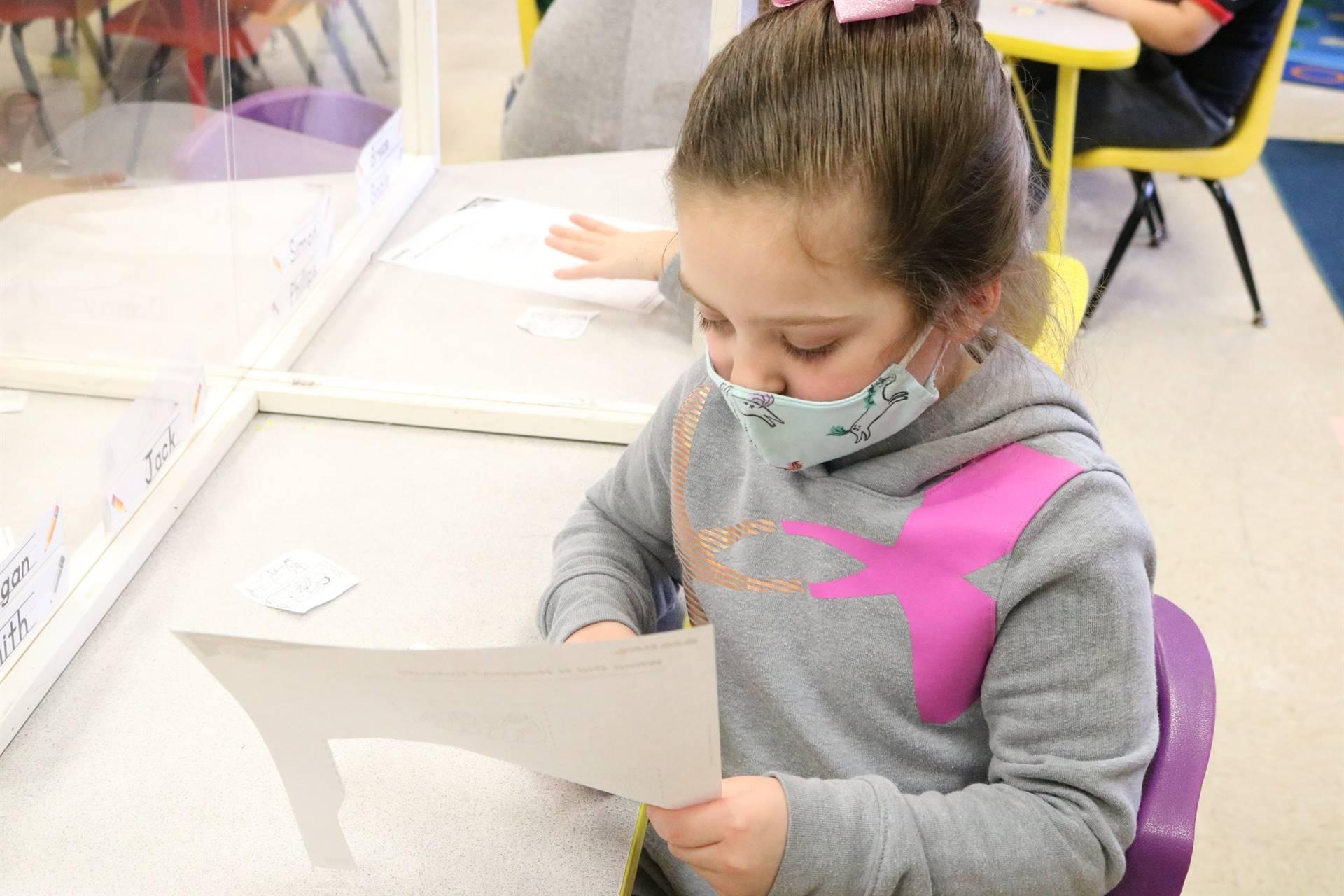girl cutting paper