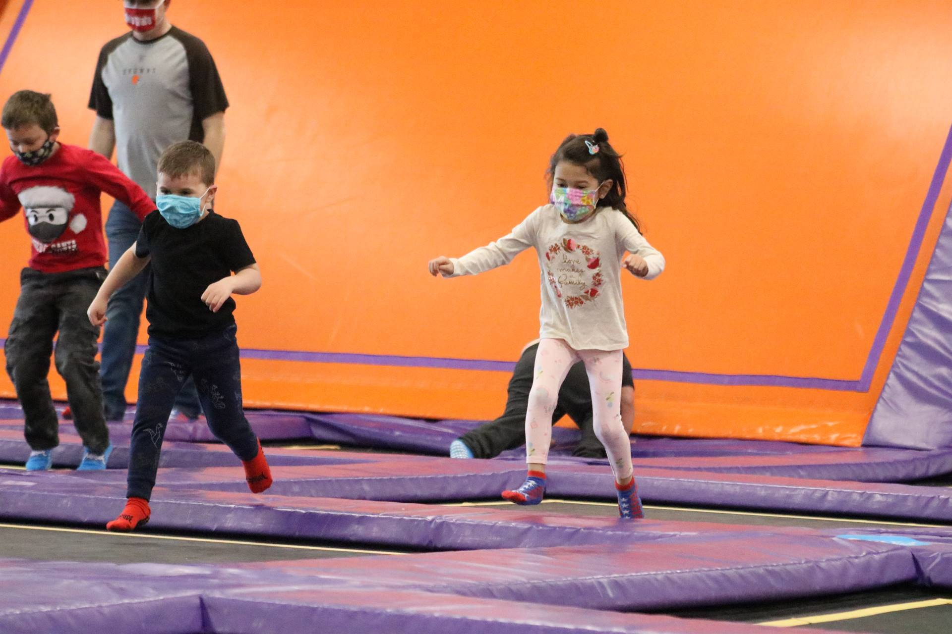 2 boys and 1 girl jumping