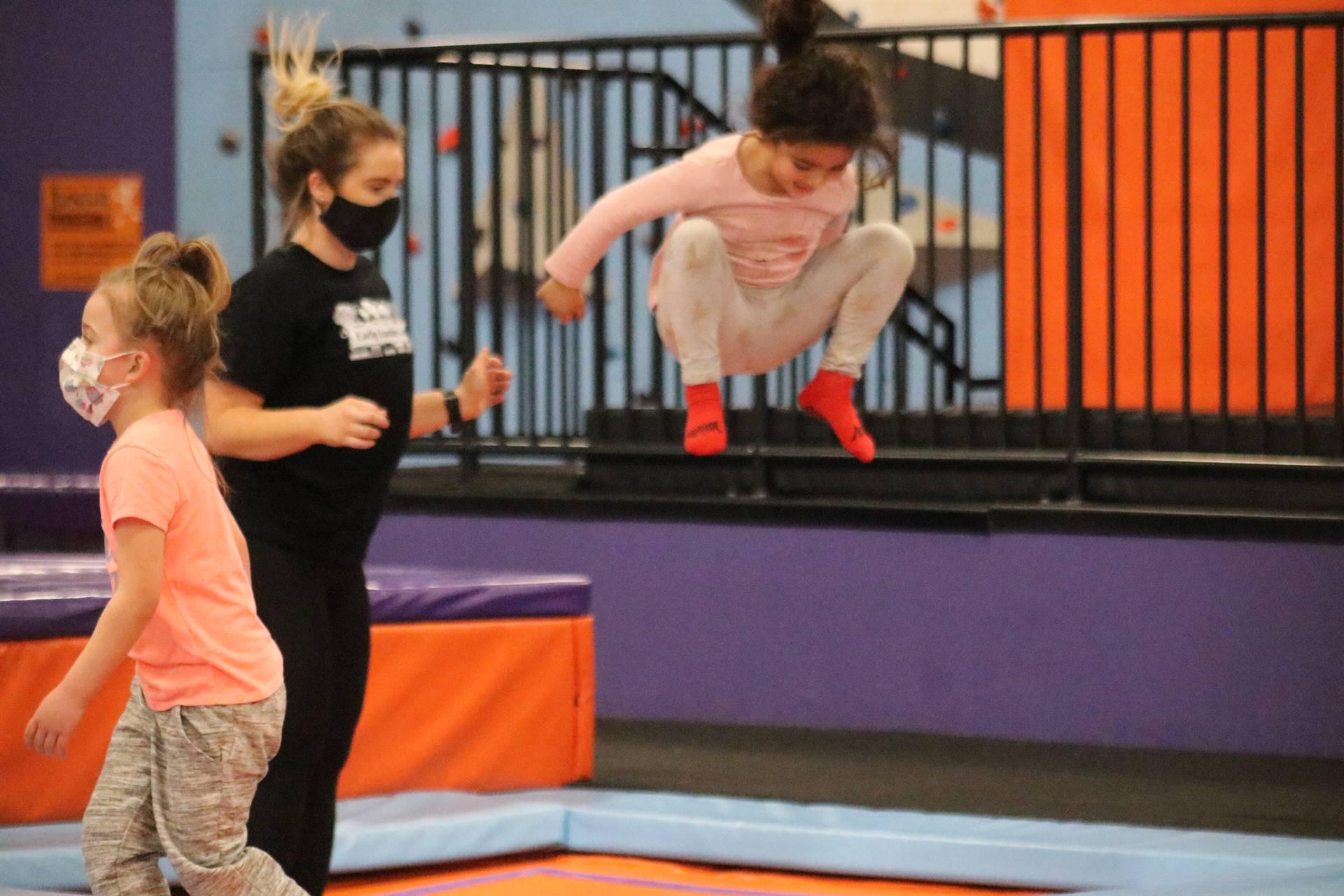 3 girls jumping