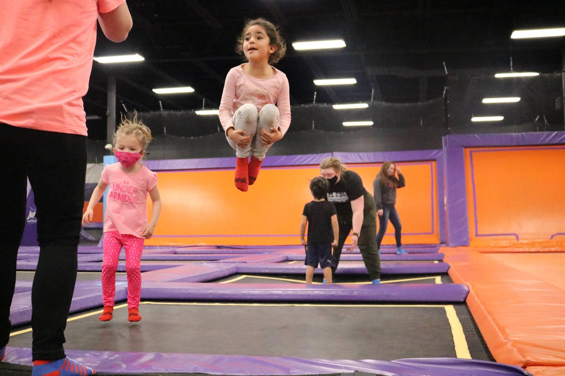 2 girls jumping