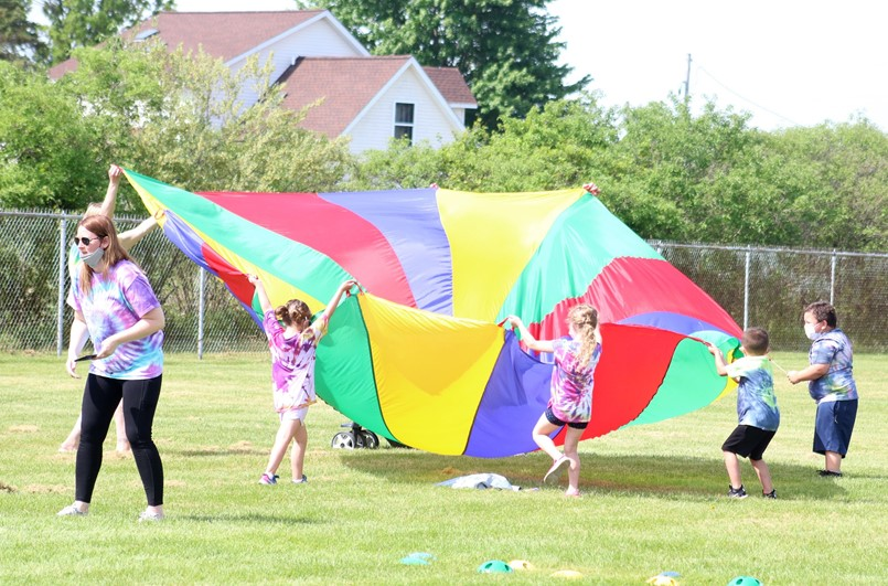 kids using big parchute